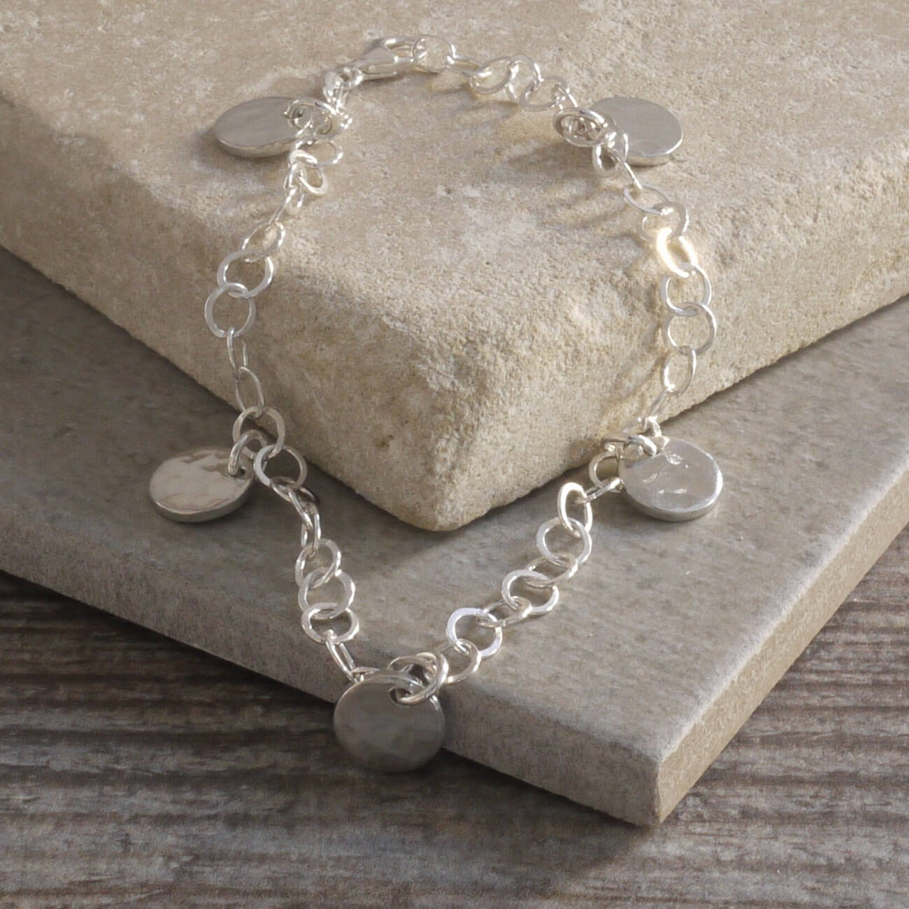 Silver bracelet with tin charms